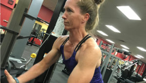 Amy Miller flex co owner fitness coach doing cable crossovers and getting fit